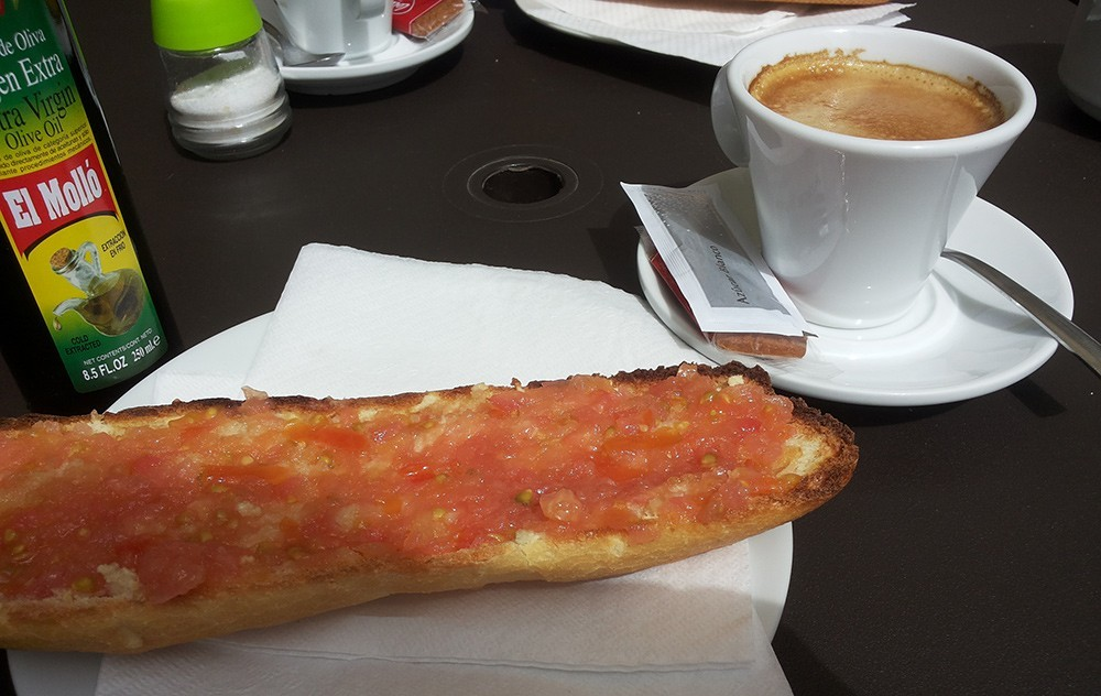 a traditional Spanish breakfast: pan con tomate and a cafe con leche