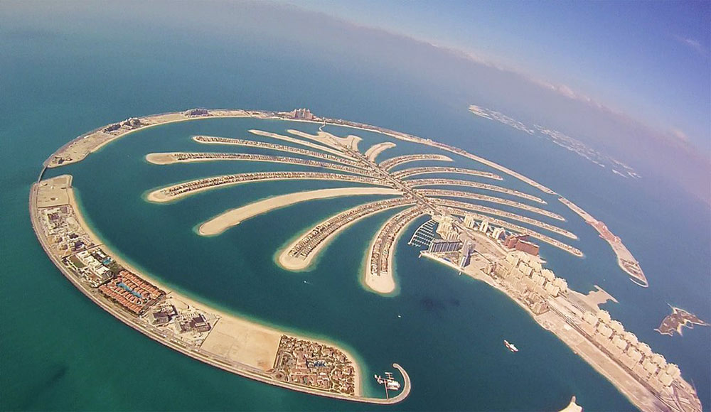 Palm island in Dubai seen from the sky during construction
