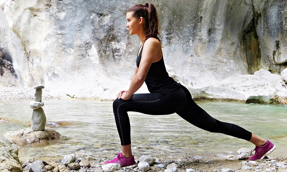 A woman exercising to stay healthy while traveling long term