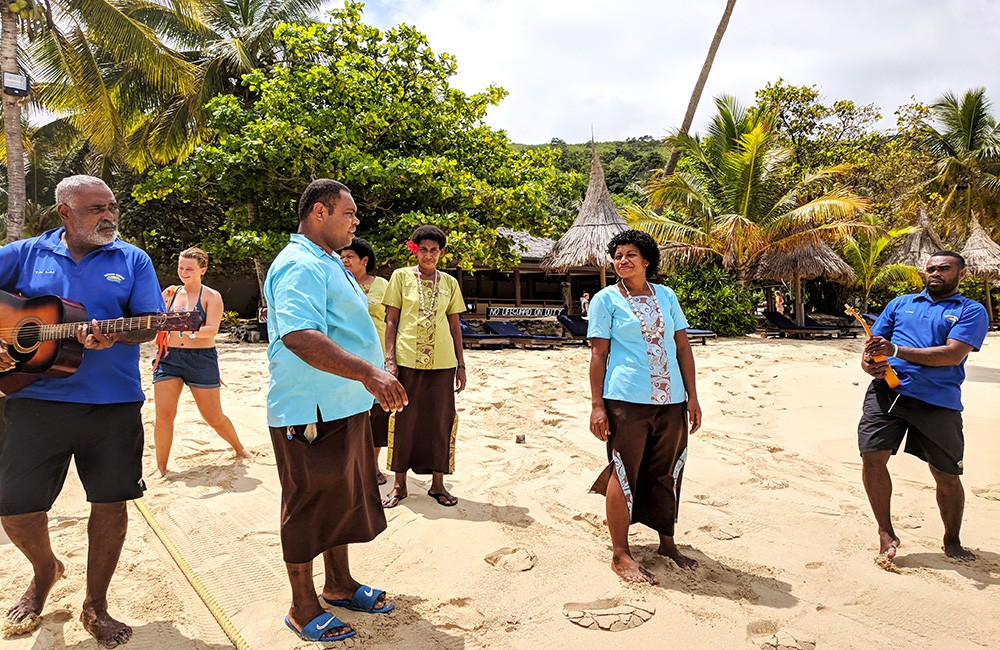 a group of locals singing in Fiji