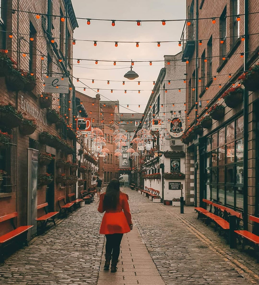 woman standing in the middle of a street in Belfast