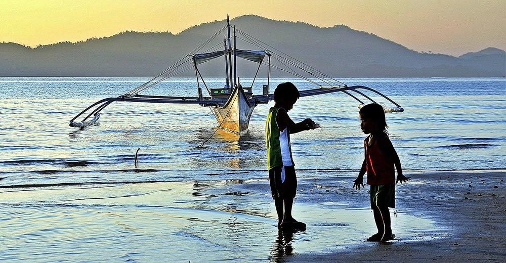 Filipino kids playing on the beach in Boracay