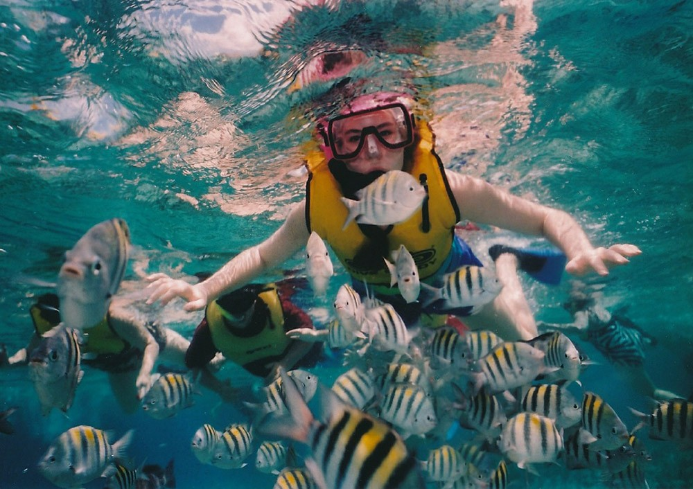 a boy's first time snorkeling with a life jacket