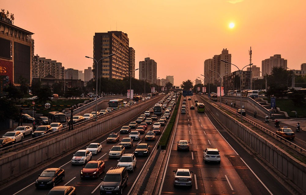 busy traffic in Beijing at sunset