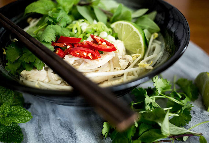 a bowl of Pho: popular Vietnamese street food
