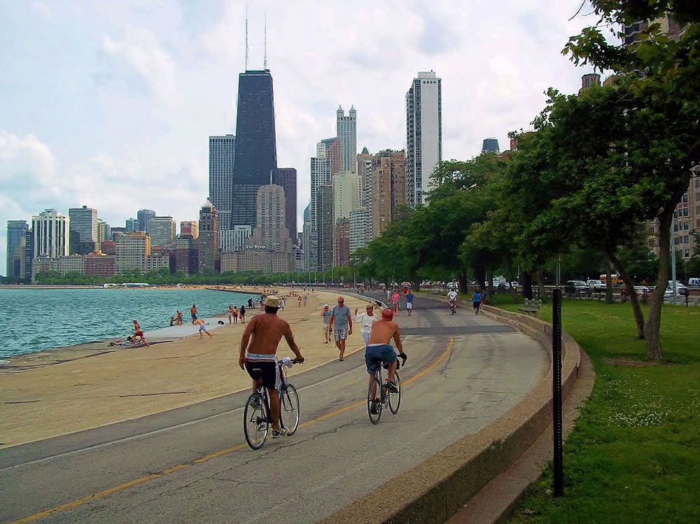 people walking and cycling along the Lakefront Trail