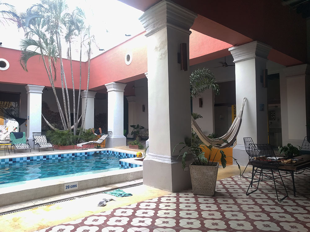 pool and courtyard in a hostel