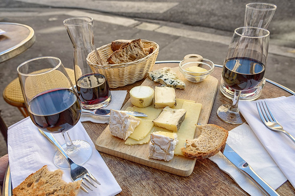 a table in Paris with wine and cheese
