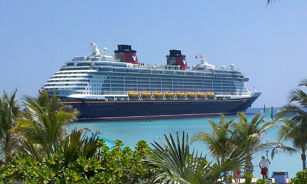 A Disney Cruise in front of Castaway Cay