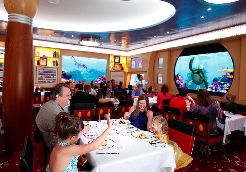 a family dining on a Disney Cruise