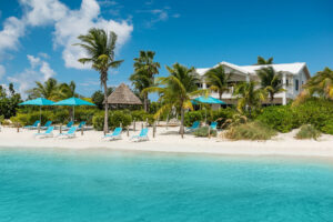 view from the beach to a luxury villa in Turks and Caicos