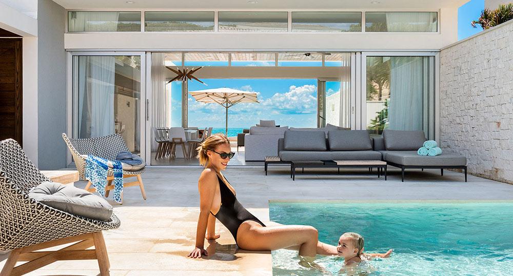 the pool area of one of the Wymara villas