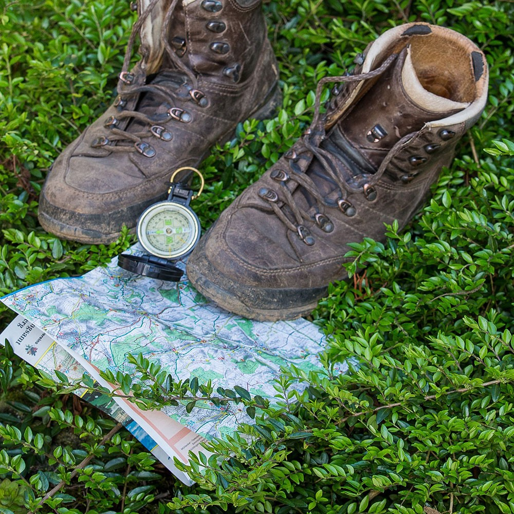 a map, compass and hiking shoes