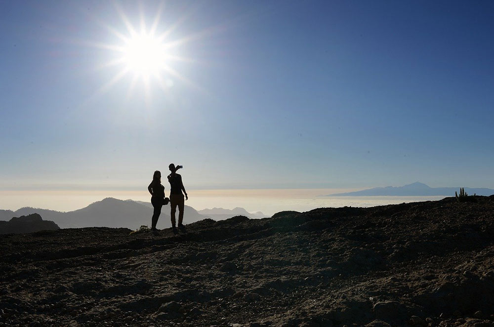a couple taking a picture on their hike
