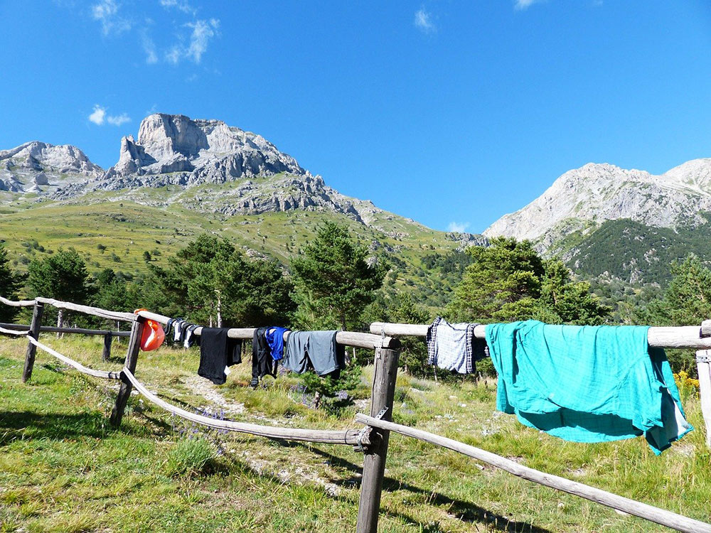 clothes drying on a fence along a hike