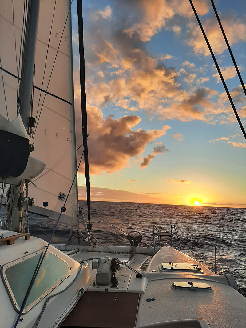 sailing into the sunset on day one of crossing the Atlantic