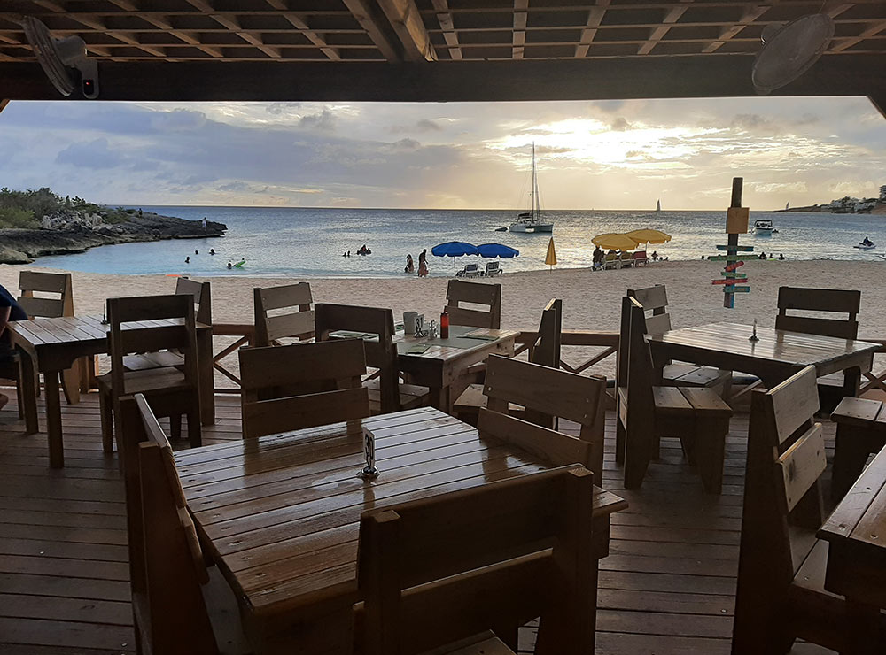 view of Mullet Bay from a beach bar